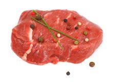 Juicy, fresh beef steak with spices Royalty Free Stock Photography