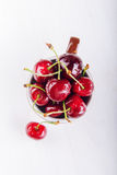 Juicy fresh cherries in brown cup Royalty Free Stock Photos
