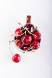 Juicy fresh cherries in brown cup Stock Photos