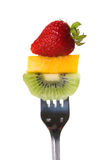 Juicy Fresh Fruit On A Fork Royalty Free Stock Photos
