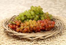 Juicy fresh red and white grapes  in a wattled basket Royalty Free Stock Image