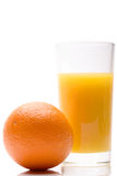 Juicy fresh orange with the glass of juice Royalty Free Stock Image