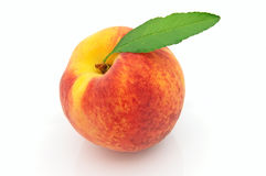 Juicy fresh peach with leaves Stock Image