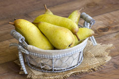 Juicy fresh pears in a basket Royalty Free Stock Image
