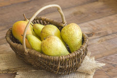 Juicy fresh pears in a basket Stock Photography