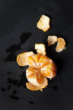 Juicy fresh peeled a tangerine Royalty Free Stock Photography