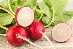 Juicy fresh radish in a cut on a white wooden background close up. Stock Image