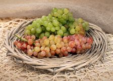 Juicy fresh red and white grapes  in a wattled basket Stock Photography