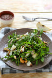 Juicy fresh salad with arugula and pear Royalty Free Stock Photography