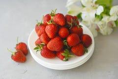 Juicy Fresh Strawberries White Plates Textured Cement Background Summer Fruit Vitamine Fresh Organic diet. Juicy Fresh Strawberries White Plates Textured Cement stock photos