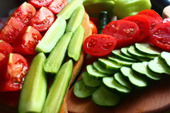 Juicy fresh tomatoes and cucumbers. Necessary vitamins in chopped tomatoes and cucumbers Stock Image