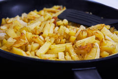 Juicy fried potatoes in a pan Stock Images