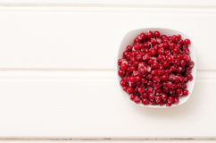 Juicy frozen berries in a small Cup.  Royalty Free Stock Photos