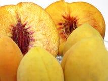 Juicy fruit. Four apricots near peach's halfs Stock Photo