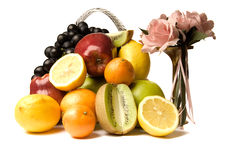 Juicy fruit and bouquet of roses Royalty Free Stock Photo