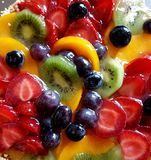 Juicy fruit cake with various fruits. Yummy!. Juicy fruit cake with different fruits: strawberries, kiwis and blueberries. Yummy stock image