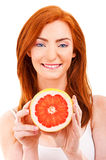 Juicy fruit A close-up of a pretty lady's face Royalty Free Stock Image