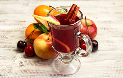 Juicy fruit and mulled wine Royalty Free Stock Images