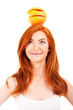 Juicy fruit over woman head Royalty Free Stock Photo