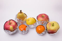 Juicy fruit, yellow pear, apple, lemon and orange tangerines wra Stock Images