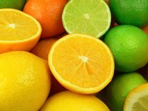 Juicy fruits. Citrus fruits. Lemons, oranges and limes Royalty Free Stock Photos