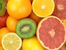 Juicy fruits. Grapefruits, oranges, lemons and kiwi fruits Royalty Free Stock Images
