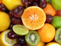 Juicy fruits. Orange, grapes, limes, lemons, grapefruit and kiwi fruits Royalty Free Stock Photos