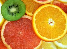 Juicy fruits. Set of different slices of fruits Stock Image