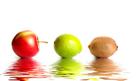 Juicy fruits. Reflected in the water stock image