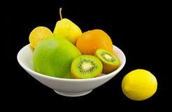 Juicy fruits. Isolated on black background Stock Image