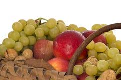 Juicy fruits in a wicker basket Stock Photos