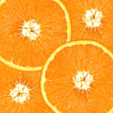Juicy Fruity Slices. Four overlapping slices of orange stock photo