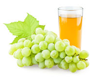 Juicy grape with leaf and full glass of juice. On white background stock images