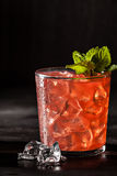 Juicy grapefruit drink on dark table Royalty Free Stock Photos