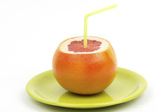 Juicy grapefruit with straw Royalty Free Stock Photography