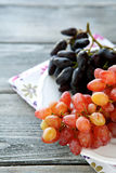 Juicy grapes on a plate Stock Photos