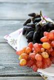 Juicy grapes on a plate. Closeup Stock Photos