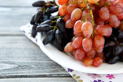 Juicy grapes on a white plate. Food closeup Royalty Free Stock Photo