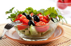 Juicy Greek salad in  glass salad bowl Royalty Free Stock Photo