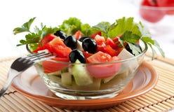 Juicy Greek salad in  glass salad bowl.  Royalty Free Stock Photo