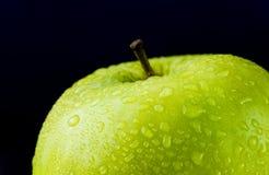 Juicy green apple on black Royalty Free Stock Photo