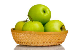 Juicy green apples in the basket Stock Photos