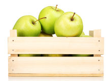 Juicy green apples in a wooden crate. Over the white Stock Photos