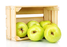 Juicy green apples in a wooden crate. Over the white Royalty Free Stock Photos