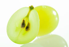 Juicy green grapes. Macro shot of cut berries on white background Stock Photo