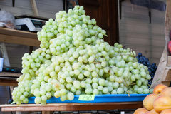 Juicy green grapes on a counter of shop Stock Photography
