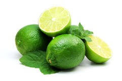 Juicy green lime  and leaf of mint Stock Photo