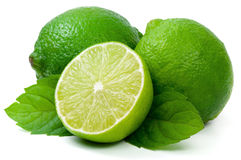 Juicy green lime and leaf of mint. Juicy green lime isolated on white background royalty free stock photography