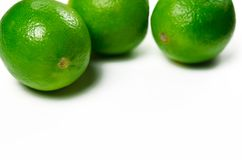 Juicy green limes are on a white background royalty free stock photo