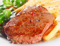 Juicy Grilled Beef on White Plate with Fries Royalty Free Stock Photos